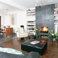 Slate-mantel-storage--living-room--25-Beautiful-Homes
